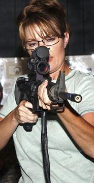 Sara Pallin mirando em Obama